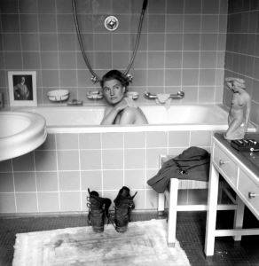 <i>Lee Miller in Hitler's Bathtub</i> (1945). Miller and LIFE photographer David Scherman were practically inseparable during the War. They staged this photograph while staying in Eva Braun's house, purposefully setting her boots - covered in mud from their recent assignments at concentration camps - on the fluffy white bathmat. LIFE Picture Collection/Getty Images, by David E. Scherman