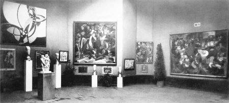 This photograph of the 1912 Salon d'Automne shows paintings (from left to right) by Frantisek Kupka, Jean Metzinger, Francis Picabia, and Henri Le Fauconnier, as well as a sculpture by Joseph Csaky, front left, with two sculptures by Amedeo Modigliani behind it.