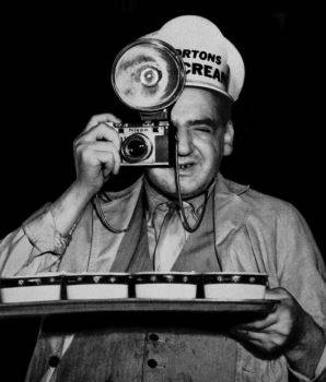 Weegee reenacting how he did his infrared flash theatre photography, disguised as an ice cream vendor