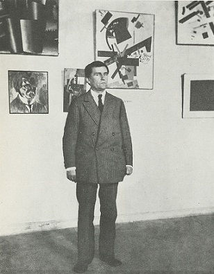 Kazimir Malevich surrounded by his works at an exhibition